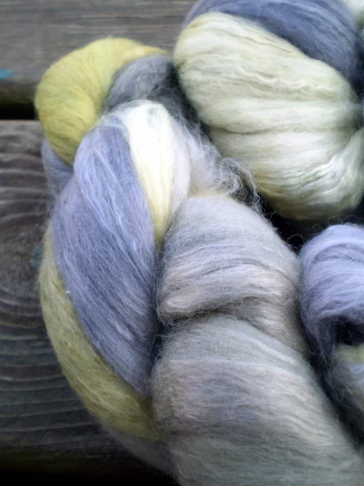 Alpaca Yarn in blues and lime green. Alpaca is a super warm fiber perfect for knitting sweaters.