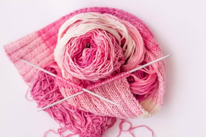 Bamboo Yarn in shades of pink on double pointed needles. Bamboo Yarn is soft and lightweight.