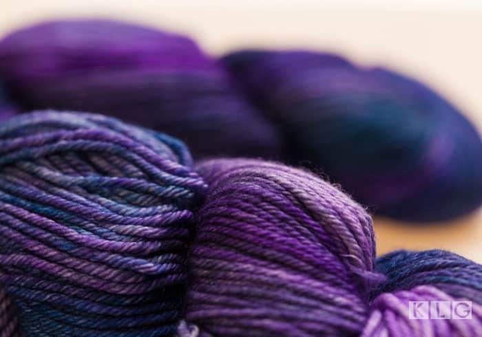 Skeins of hand dyed purple yarn