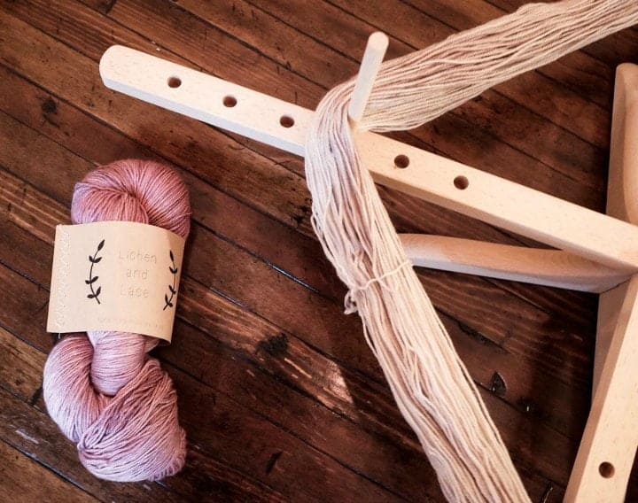 Amish Yarn Swift with pink yarn used by Woolen Whimsey
