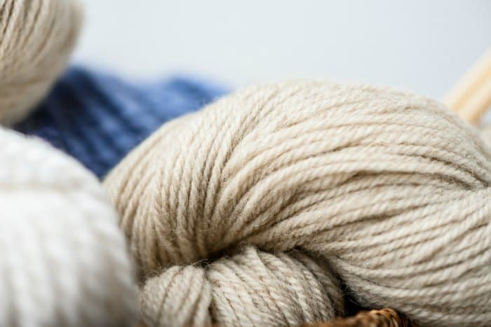 Skeins of wool in cream, blue and white