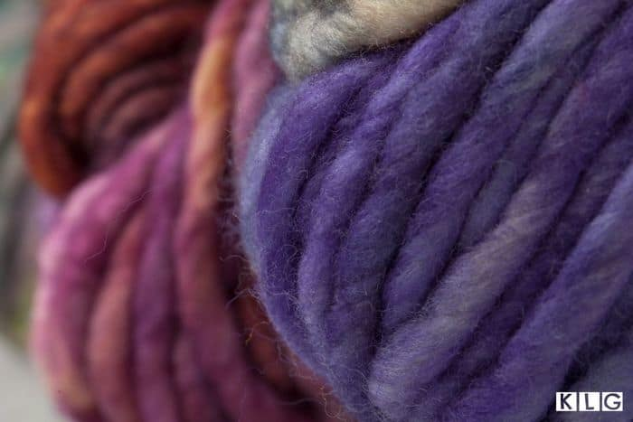 Closeup of Hand Dyed Yarns in purples and reds
