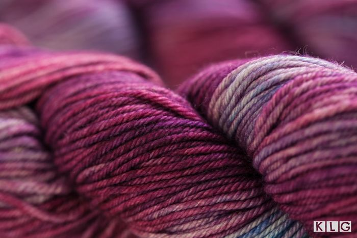 Hand dyed yarn in purples and reds. My Guide To Portuguese Knitting