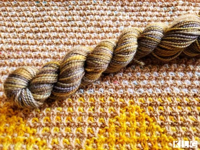 Koigu KPPM hand painted yarn in golds, greys and browns