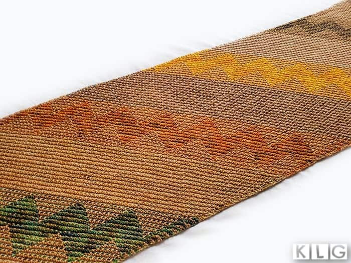 Kentia Wrap knitted by Jodie at Knit Like Granny featuring the mosaic sections in greens, orange and yellow