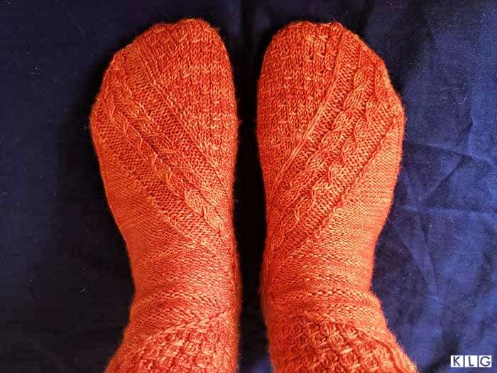Two socks complete. So happy with my Smaug socks