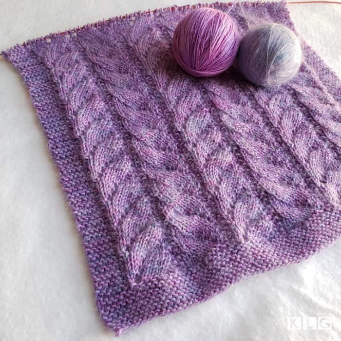 Progress of my Chasing Light Shawl in Rosehip Island Merino Silk and Mohair Silk yarns in purples and blues