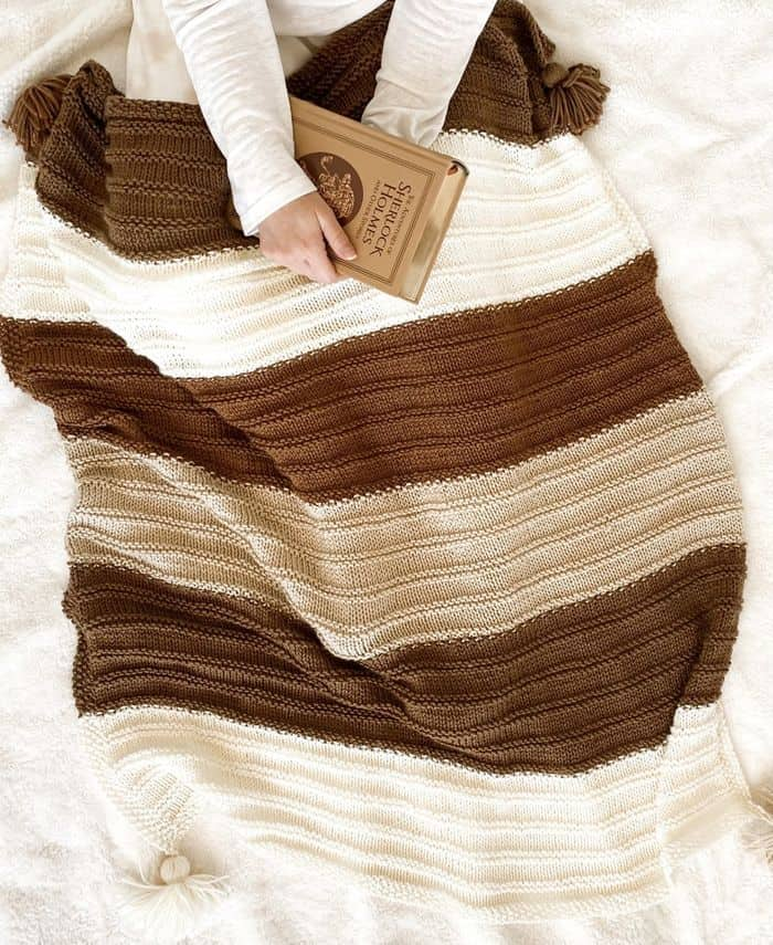 Lion Brand Yarn Berkshire Throw Kit in browns and cream colored yarns.