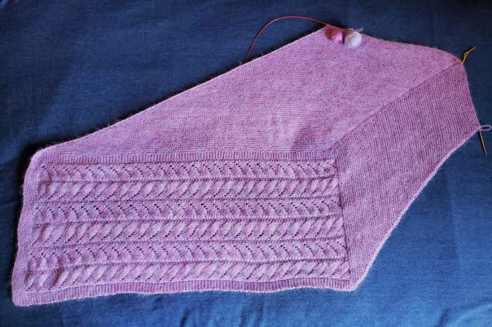 the garter stitch section of my Chasing light shawl halfway complete. There are two small balls of yarn left.