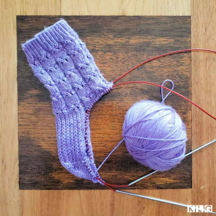 Fairy Maiden Socks Progress. Stitches arranged on the needles in magic loop, to start the gusset decrease stitches.